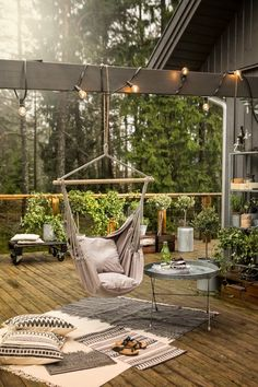 If this isn't the perfect outdoor haven, I don't know what is. Porch swing!