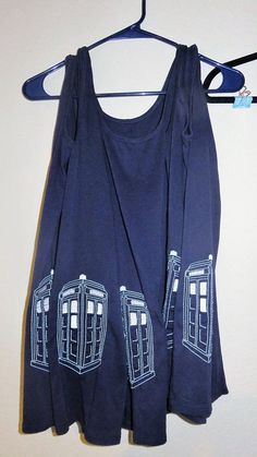Doctor Who fan? This soft Tardis tank is your baby! The Tardis is stylishly offset at the bottom of the tank and even glows in the dark! Tank 58% cotton, 39% modal, 3% spandex  100% polyester embroidery design  Machine Wash & Dry (details on tank care tag)  Only non-chlorine bleach when needed.  Cool iron
