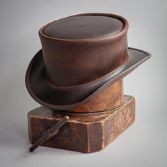 Now welcome to the Ashbury Hats line, the Dimebag is a leather top hat style based on one of our our popular designs, utilizing a unique leather that is smooth as butter, and retains a lot of pull-up meaning this hat will get more and more character as you wear it. #hats #tophats Leather Top Hat, Steampunk Top Hat, Hat Hooks, Hats Online, Marlow, Outfits With Hats, Cool Hats, Hat Making, Leather Accessories