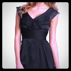 Beautiful black chiffon dress- Adrianna Papell Pictures don't do it justice . Worn only once . I couldn't carry off the low neckline . But it's gorgeous !!  Adrianna Papell Dresses