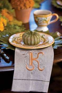 Monogrammed tea towels lend a festive fall feel while serving as place cards and party favors