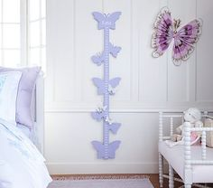 With butterfly cutouts adorning the ruler, this growth chart adds charming design to your child's room. Add a name to make it a keepsake.