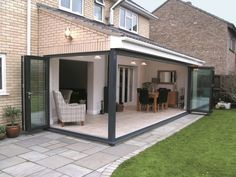 Garden room bi-folds from Midland bifolds. Garden room bi-folds from Midland bifolds. House Exterior, New Homes, Outdoor Rooms, House Extension Design, House, Patio Doors, Building A House, Garden Room Extensions, Folding Doors