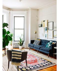 Layered rugs, wall gallery art and a plant invasion. On repeat. #thatswhatshesaid #followmylead #livingroomdecor #designtips #MOMme | pic…
