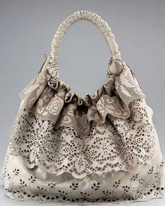 Valentino Laceland Tote. A combination of leather, lace and ruffles, this tote is bliss.