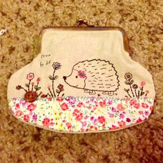 "Coin Purse Coin purse with ""free to be"" written on design. Perfect gift for anyone! Never used. Natural Life Bags"