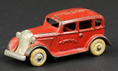 "1933 Arcade Plymouth Sedan, scarce advertising example, cast iron, painted in red, white roof lettering reads, ""A Century of Progress, Chicago 1933,"" features nickel grille, rubber tires. 4 1/8"" L"