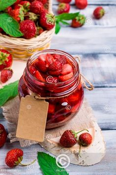 Slices of red strawberries with syrup in a glass jar on a wooden table. Wooden Tables, Glass Jars, Fresh Fruit, Syrup, Strawberries, Vegetables, Cooking, Red, Wood Tables