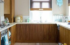Coordinate, Coordinate, Coordinate   There's no denying it, a coordinated look, where units are matched with trims in blinds, where the wall colour echoes the flooring, and where accessories are subtly similar, will always make a small kitchen feel more streamlined, and as a result, much larger.