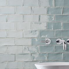 The SomerTile Thames Acqua 3 in. x 6 in. Ceramic Wall Tile has a unique handmade look. Glossy blue glaze, watercolor finish, natural variations in the surface. Versatile look and soft color for a soot