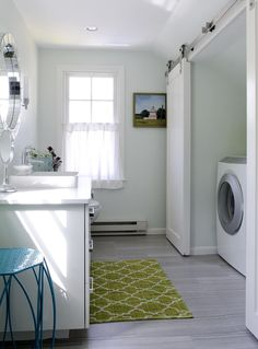 laundry behind sliding barn doors