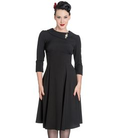 Elegant vintage style cocktail dress with A-symmetrical collar detail finished with attached rhinestone brooch.  Empire line cut with gathered underbust seam.  Flattering 3/4 length sleeves.  Zip to centre back.  Flared lower skirt section.  Unlined.  Machine washable (do not tumble dry)  Material: 97% Polyester 3% Elastane (crepe like fabric/appearance)  Length : Knee Length