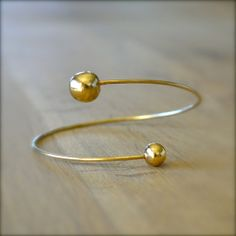 Gold Open Bangle With 2 Balls by illuminancejewelry on Etsy, $48.00