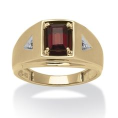 This stylish ring from Neno Buscotti offers a large emerald-cut garnet center stone accompanied by a pair of white diamond accents. This jewelry is rendered in sleek 10-karat yellow gold and shines wi
