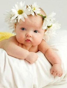 Adorable baby girl with flower headband. Disorganized
