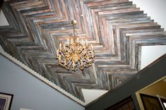 She nails reclaimed wood to her living room ceiling. A few weeks later? My jaw is on the floor!