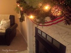 Simple Christmas Mantle - #Christmas  #Fireplace #Mantle #Holiday #Decor #Garland #Evergreen #Berries #Pinecones #Burlap