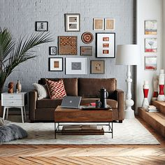 gray living room with chocolate brown sofa, gray painted brick wall, benjamin moore french press