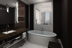 Peek-a-boo style bathrooms in an Istanbul hotel put bathtubs on display, as well as great city views!