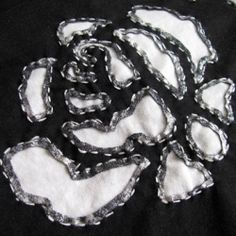 Close up of a reverse applique rose on an Alabama Stitch skirt.
