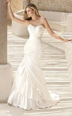 Not sure how I feel about the layers towards the bottom, but love the rest, especially the lace-up bakc.  Stella York - Style 5594