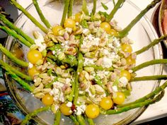 Asparagus, yellow cherry tomatoes, pistachios, goat cheese, baby greens, grilled chicken, and balsamic vinaigrette.  Yum yum!