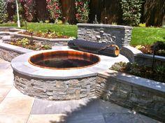 Beautiful custom cedar hot tub set in stone. www.gordonandgrant.com