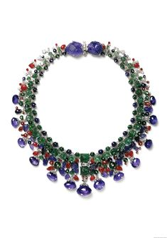 Cartier, Paris, special order, 1936, altered in 1963, Tutti Frutti necklace, platinum, white gold, marquise-, baguette-, and round old-cut diamonds, thirteen briolette-cut sapphires weighing 146.9 carat in total, two leaf-shaped carved sapphires, 50.8 and 42.45 carats, sapphire beads, one sapphire cabochon, square carved emeralds, fluted and smooth emerald beads, and emerald cabochons, 43cm.