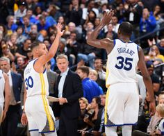 Kevin Durant and Stephen Curry of the Golden State Warriors high five during the game against the Philadelphia 76ers on November 11 2017 at ORACLE...