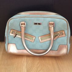 Authentic Gucci Gold trim baby blue monogram bag Like new condition! Super cute style. Gucci Bags Mini Bags