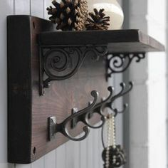 This gorgeous rustic coat hook shelf is individually handmade from reclaimed wood.Available in natural or dark oak wood finish Pre-drilled holes for wall fitting. Wall fittings not included. (please note : We do not supply these as we do not know what type of wall the product will be fitted onto as certain walls need different fittings) A great way to organise your family's coats and keys and the generous shelf are great for displaying books, mugs and jugs. This coat hook shelf would add ...