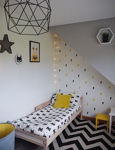 Cool, modern bedroom for kids. Trendy childs bedroom. Boys bedroom. Kids bedroom on a budget. Childs bedroom transformation. Yellow and grey in a childs bedroom. Lightening bolt wall stickers. Chevron Rug. Badman bedding. Kids interiors. Kids decor.
