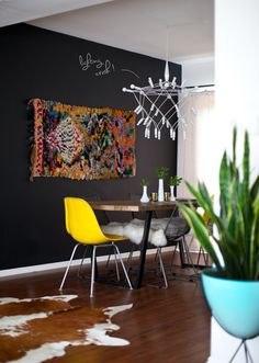 Moroccan rug on the dark wall, yellow chair, white light fixture.Love it! Decor, House Design, Room Inspiration, Interior Inspiration, Interior, Home Decor, House Interior, Room, Home Deco