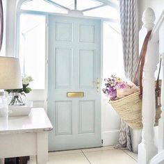 This front door has been painted in our Celestial Blue - a dusky variant of Sky Blue found on a rare surviving colour card of 1807. Image by @blossomingbirds.