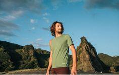 Bryce wearing Lhotse organic yoga clothing at Karekare bay, New Zealand.