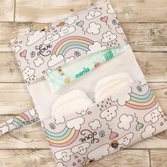 This lovely clutch bag is perfect for mums on the go. It holds a handful of nappies and a packet of wipes, and you could probably squeeze one or. Baby Sewing Projects, Sewing Projects For Beginners, Nursery Storage Baskets, Baby Shower Gifts, Baby Gifts, Billy Bibs, Period Kit, Girl Diaper Bag, Baby Sheets