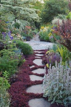 Beautiful garden path; ;love the muted colors of burgandy and silvery blues