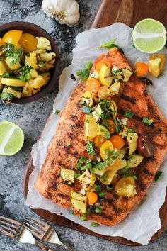 """""""The Only Grilled Salmon Recipe You'll Ever Need"""" - skin-on salmon fillet, olive oil, garlic powder, onion powder, chili powder, cayenne pepper, sea salt, salsa (zucchini squash, yellow squash, cherry tomatoes, jalapeno, garlic clove, red onion, mint leaves, lime juice, olive oil, agave nectar [omit or sub another sweetener], sea salt)"""