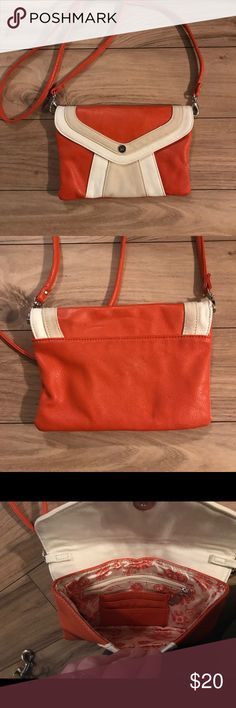 Grace Adele faux leather cross body bag Orange and cream faux leather  This bag has pockets and slots for items and cards on the inside Detachable should strap.  Envelope style enclosure 8L x 6H Bags Crossbody Bags