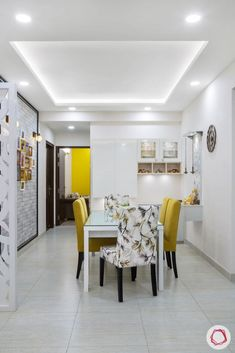 Cleo county noida_dining room with mustard yellow chairs and white crockery unit Kitchen Ceiling Design, House Ceiling Design, Ceiling Design Living Room, Bedroom False Ceiling Design, Home Ceiling, Home Room Design, Dining Room Design, Fall Celling Design, Best False Ceiling Designs