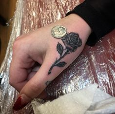 Rose Tattoo on Finger by The Black Rooster