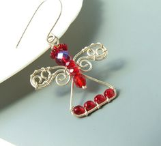 Angel Christmas ornament, angel handmade pendant, silver plated wire wrapped jewelry. $31.00, via Etsy.