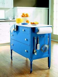 Put two locking casters on this, and a flip-up cutting board - probably ditch the paper towels and utensil holder, they would just turn into toddler toys at that height. Could craft this out of a low dresser.