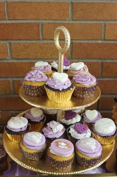 Pretty cupcakes at a lavender and gold bridal shower party! See more party ideas at CatchMyParty.com!
