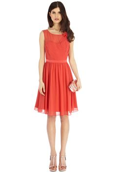 This gracefully romantic dress is an exquisite choice for any extra special occasion! The Penelope Dress is a fine example of how to effortless wear the coveted goddess like style, with its directional pleat detail at the bust and shoulder adorned in crepe rosette applique this dress is truly a unique piece. The dress is fully lined for a luxe finish and is closed with a side zip and a feminine back key hole.