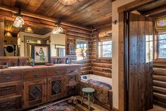 A couple finds authentic Western charm in Big Horn, Wyoming Cabin Bathrooms, Rustic Bathrooms, River Rock Fireplaces, Hickory Furniture, Inviting Home, Mountain Living, Unique Rugs, Log Homes, Interior Architecture