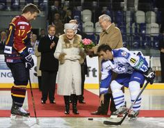 the queen watching ice hockey!