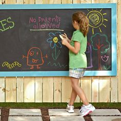 Give kids a place to create and share their outdoor artwork on this weatherproof chalkboard.