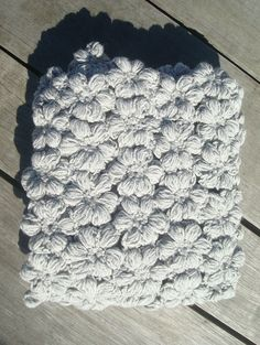 This Crochet Baby Blanket is made of 140 grey super soft flowers perfect as a Baby Blanket or as a wrap, crib, stroller or car seat blanket. Handmade by SNOOZE