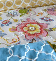 Calico Corners Fabrics--yellow geometric pillows in family room, kitchen window treatment